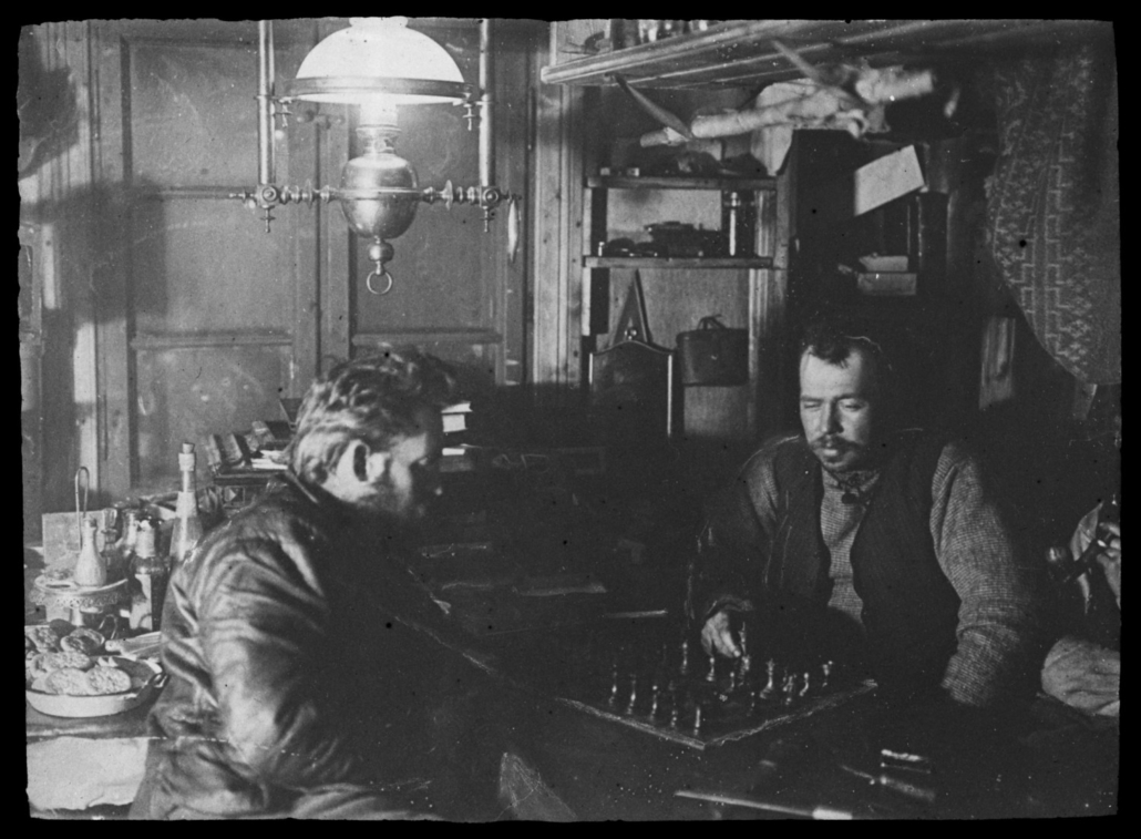 Borchgrevink (facing camera) playing chess with Klofstad.