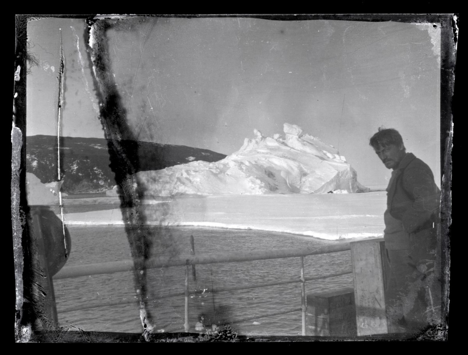 Ross Island, Antarctica. Alexander Stevens, chief scientist and geologist looks south. Hut Point Peninsula in the background